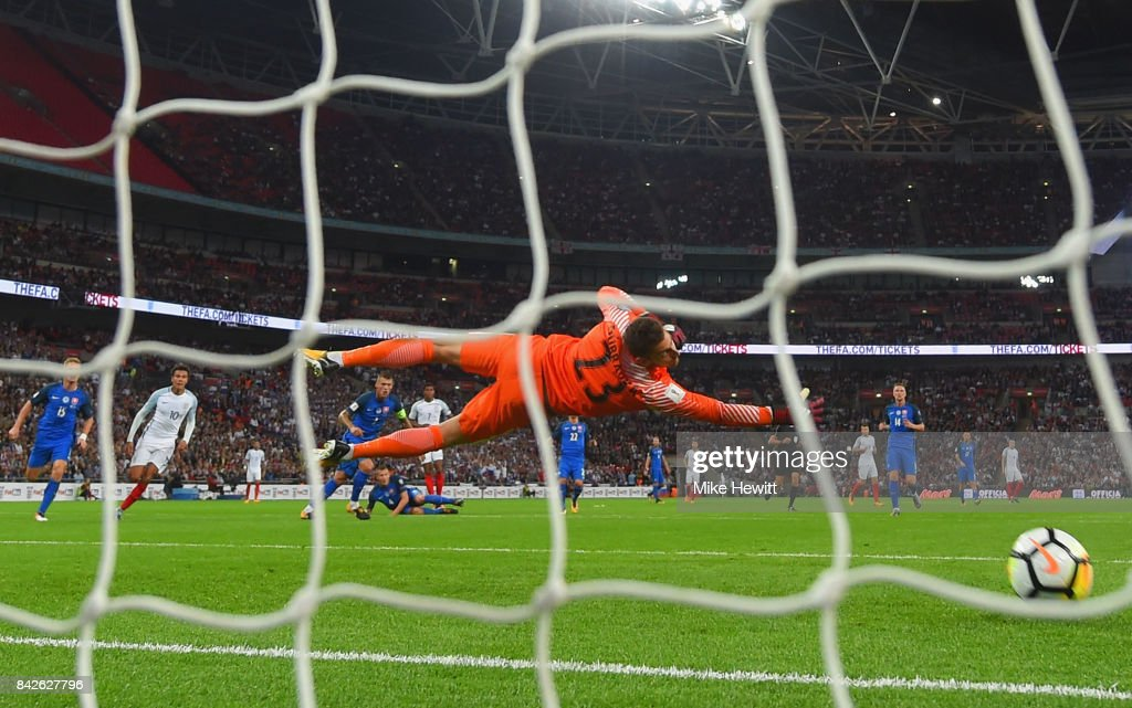 Marcus Rashford of England scores their second goal as Martin Dubravka of Slovakia dives for the ball during the FIFA 2018 World Cup Qualifier between England and Slovakia at Wembley Stadium on September 4, 2017 in London, England.