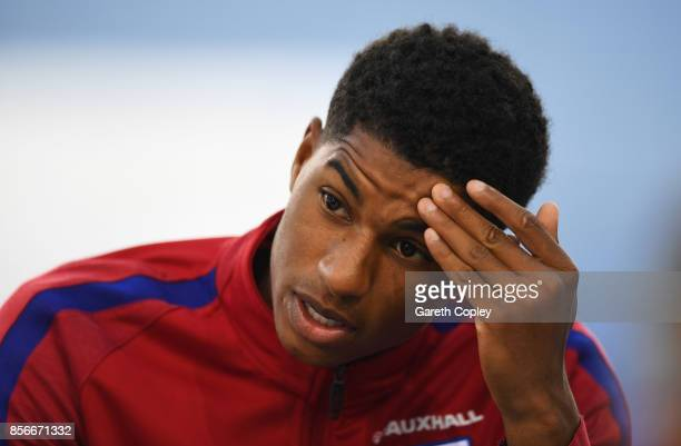Marcus Rashford of England speaks during an England media session at St Georges Park on October 2 2017 in BurtonuponTrent England England are due to...