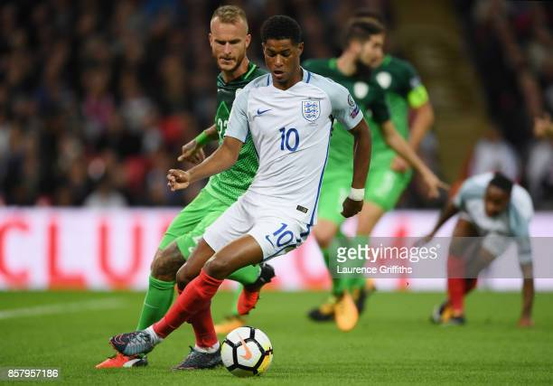 Marcus Rashford of England takes on Aljaz Struna of Slovenia during the FIFA 2018 World Cup Group F Qualifier between England and Slovenia at Wembley...
