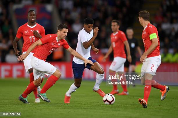 Marcus Rashford of England takes on Fabian Schaer of Switzerland during the international friendly match between England and Switzerland at The King...