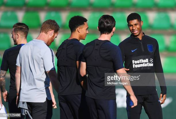 Marcus Rashford of England talks to team mates Ben Chilwell and Trent AlexanderArnold during an England training session ahead of their UEFA Nations...