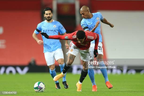 Marcus Rashford of Man Utd and Fernandinho of Manchester City during the Carabao Cup Semi Final match between Manchester United and Manchester City...