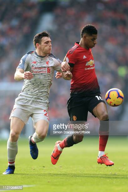 Marcus Rashford of Man Utd battles with Andrew Robertson of Liverpool during the Premier League match between Manchester United and Liverpool at Old...