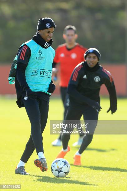 Marcus Rashford of Man Utd battles with Ashley Young of Man Utd during a training session ahead of their UEFA Champions League match against Sevilla...