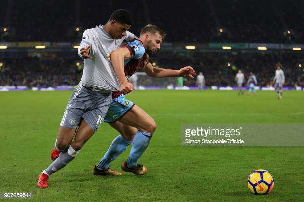 Marcus Rashford of Man Utd battles with Charlie Taylor of Burnley during the Premier League match between Burnley and Manchester United at Turf Moor...