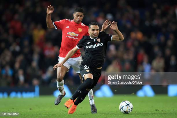 Marcus Rashford of Man Utd battles with Gabriel Mercado of Sevilla during the UEFA Champions League Round of 16 Second Leg match between Manchester...