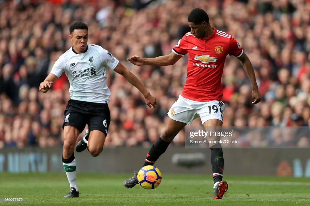 Marcus Rashford of Man Utd battles with Trent Alexander-Arnold of Liverpool during the Premier League match between Manchester United and Liverpool at Old Trafford on March 10, 2018 in Manchester, England.