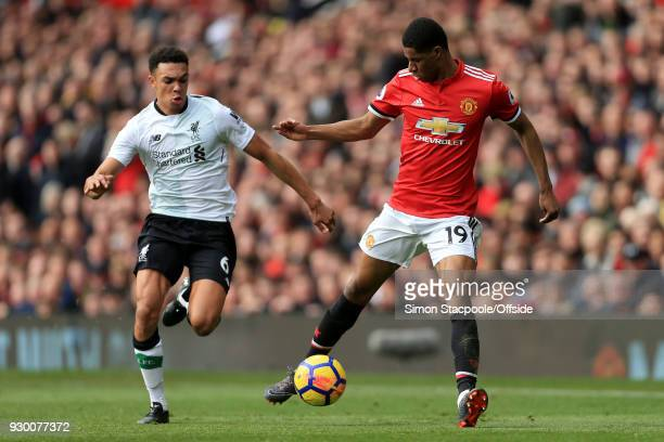 Marcus Rashford of Man Utd battles with Trent AlexanderArnold of Liverpool during the Premier League match between Manchester United and Liverpool at...
