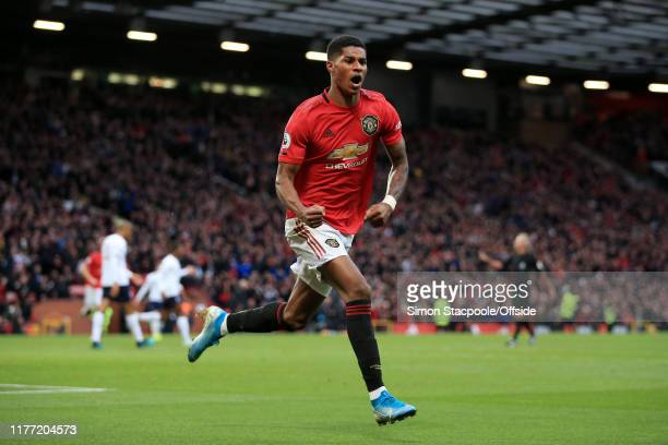 Marcus Rashford of Man Utd celebrates after scoring their 1st goal during the Premier League match between Manchester United and Liverpool FC at Old...