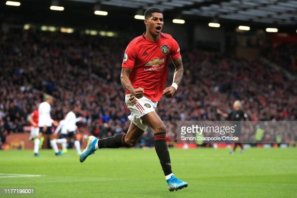 Marcus Rashford of Man Utd celebrates scoring the opening goal during the Premier League match between Manchester United and Liverpool FC at Old...