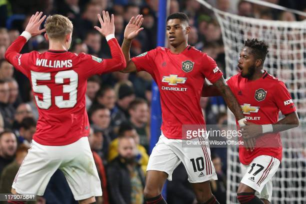 Marcus Rashford of Man Utd celebrates scoring the opening goal from the penalty spot with Brandon Williams and Fred during the Carabao Cup Round of...