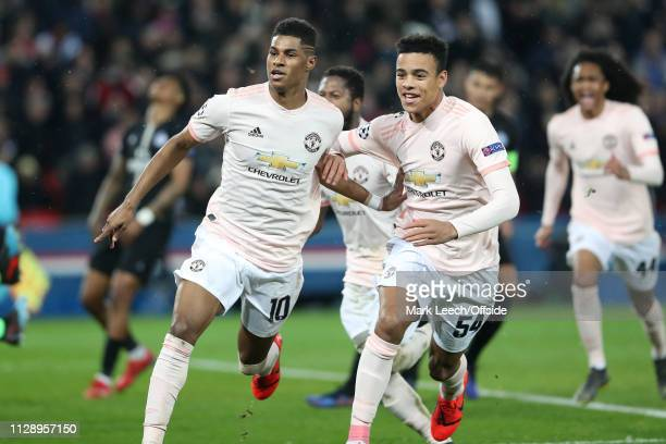 Marcus Rashford of Man Utd celebrates scoring the winning goal from the penalty spot with Mason Greenwood during the UEFA Champions League Round of...