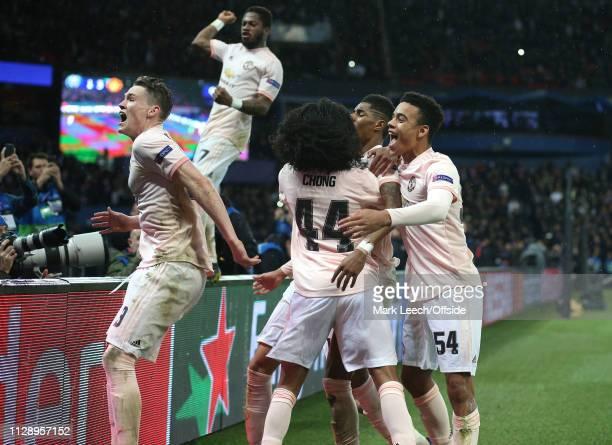 Marcus Rashford of Man Utd celebrates scoring the winning goal from the penalty spot with Scott McTominay, Tahith Chong and Mason Greenwood during...