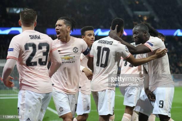 Marcus Rashford of Man Utd celebrates scoring the winning goal from the penalty spot with Chris Smalling and Romelu Lukaku during the UEFA Champions...