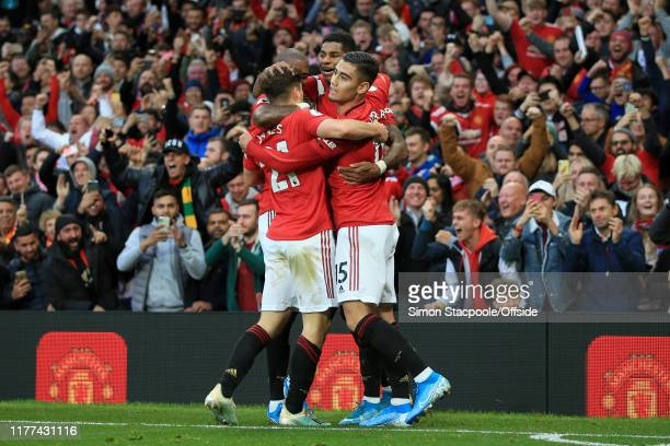 Marcus Rashford of Man Utd celebrates with teammates including Andreas Pereira of Man Utd after scoring their 1st goal during the Premier League...