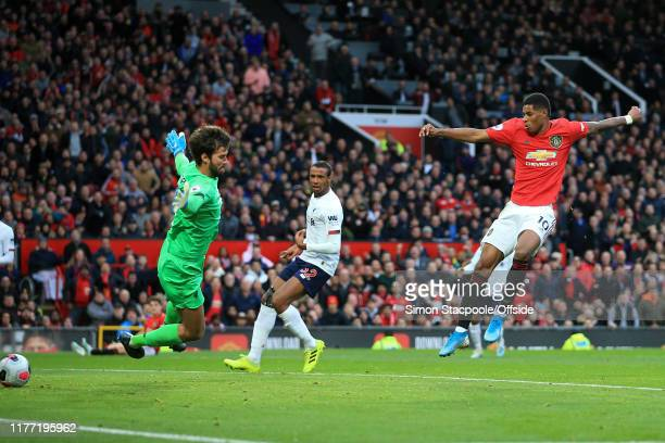 Marcus Rashford of Man Utd scores the opening goal during the Premier League match between Manchester United and Liverpool FC at Old Trafford on...