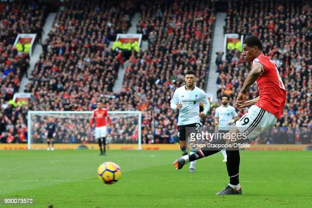 Marcus Rashford of Man Utd scores their 2nd goal during the Premier League match between Manchester United and Liverpool at Old Trafford on March 10...