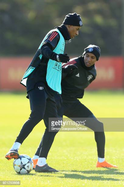 Marcus Rashford of Man Utd shields the ball from Ashley Young of Man Utd during a training session ahead of their UEFA Champions League match against...