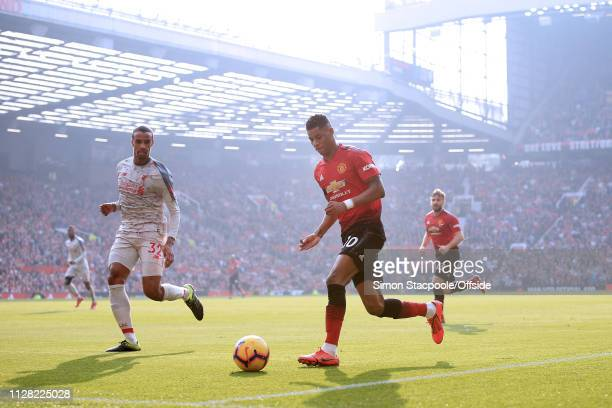 Marcus Rashford of Man Utd takes on Joel Matip of Liverpool during the Premier League match between Manchester United and Liverpool at Old Trafford...
