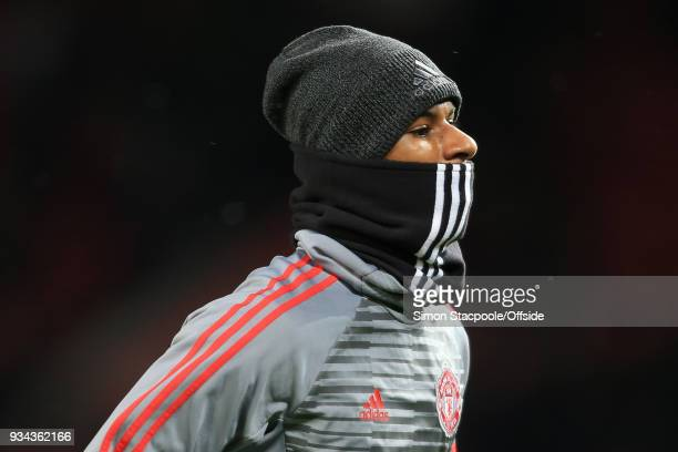 Marcus Rashford of Man Utd wears a snood before The Emirates FA Cup Quarter Final match between Manchester United and Brighton and Hove Albion at Old...