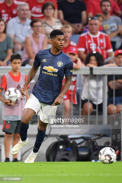 Marcus Rashford of Manchester plays the ball during the friendly match between Bayern Muenchen and Manchester United at Allianz Arena on August 5...