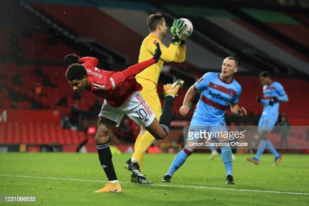 Marcus Rashford of Manchester United almost loses his footing after West Ham United goalkeeper Lukasz Fabianski makes a save during The Emirates FA...