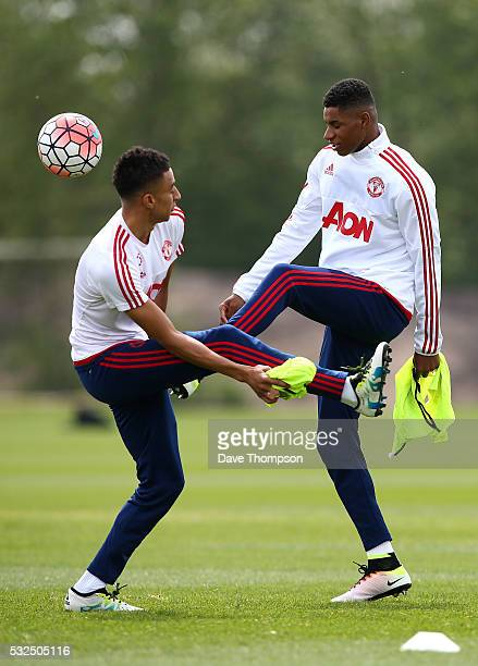 Marcus Rashford of Manchester United and Anders Lindegaard of Manchester United take part in a drill during a training session ahead of the FA Cup...