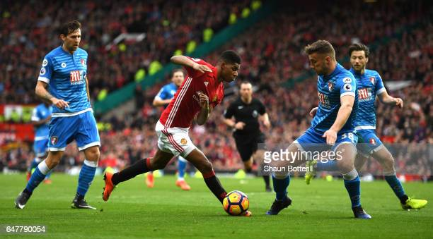 Marcus Rashford of Manchester United and Baily Cargill of AFC Bournemouth battle for possession during the Premier League match between Manchester...