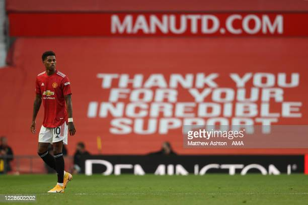 Marcus Rashford of Manchester United and charity fundraiser in front of a banner thanking for incredible support during the Premier League match...