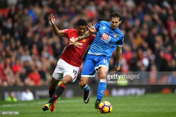 Marcus Rashford of Manchester United and Charlie Daniels of AFC Bournemouth battle for possession during the Premier League match between Manchester...