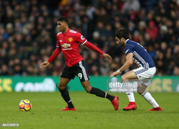 Marcus Rashford of Manchester United and Claudio Yacob of West Bromwich Albion during the Premier League match between West Bromwich Albion and...