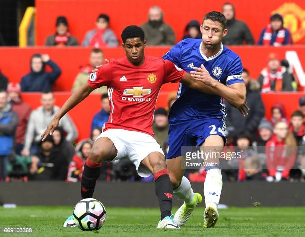 Marcus Rashford of Manchester United and Gary Cahill of Chelsea battle for possession during the Premier League match between Manchester United and...