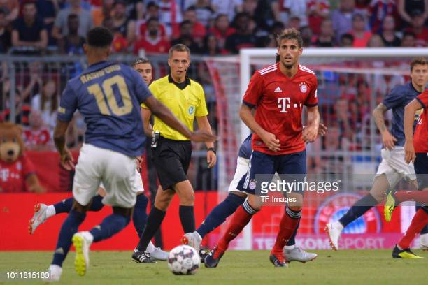 Marcus Rashford of Manchester United and Javi Martinez of Bayern Muenchen battle for the ball during the friendly match between Bayern Muenchen and...