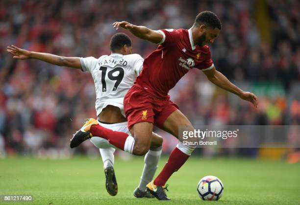 Marcus Rashford of Manchester United and Joe Gomez of Liverpool battle for possession during the Premier League match between Liverpool and...