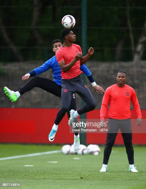 Marcus Rashford of Manchester United and Joel Castro Pereira of Manchester United battle to win a header during a Manchester United training session...
