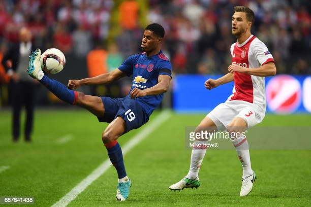 Marcus Rashford of Manchester United and Joel Veltman of Ajax in action during the UEFA Europa League Final between Ajax and Manchester United at...