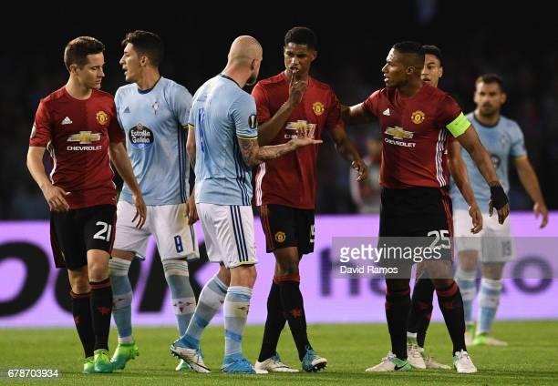 Marcus Rashford of Manchester United and John Guidetti of Celta Vigo clash during the UEFA Europa League semi final first leg match between Celta...