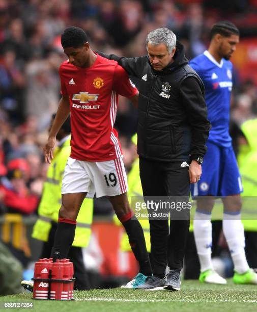 Marcus Rashford of Manchester United and Jose Mourinho Manager of Manchester United embrace during the Premier League match between Manchester United...