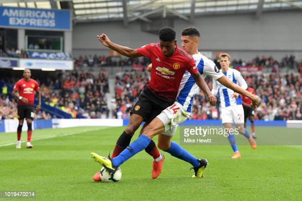 Marcus Rashford of Manchester United and Leon Balogun of Brighton and Hove Albion battle for the ball during the Premier League match between...