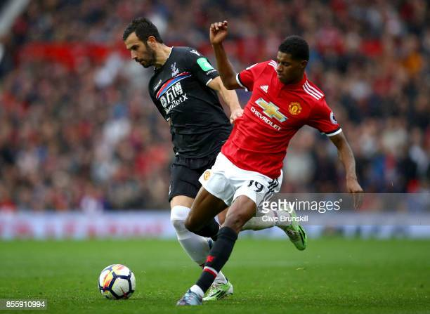 Marcus Rashford of Manchester United and Luka Milivojevic of Crystal Palace compete for the ball during the Premier League match between Manchester...