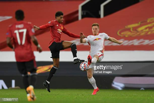 Marcus Rashford of Manchester United and Marcel Halstenberg of RB Leipzig battle for the ball during the UEFA Champions League Group H stage match...