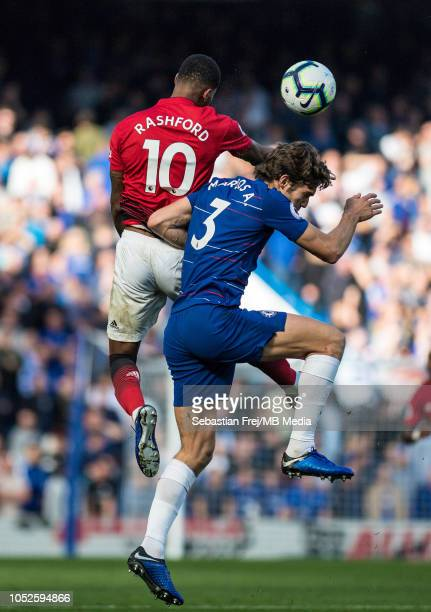 Marcus Rashford of Manchester United and Marcos Alonso of Chelsea jump for ball during the Premier League match between Chelsea FC and Manchester...