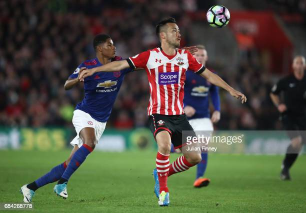 Marcus Rashford of Manchester United and Maya Yoshida of Southampton battle for possession during the Premier League match between Southampton and...