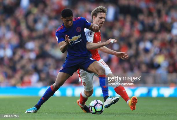 Marcus Rashford of Manchester United and Nacho Monreal of Arsenal compete for the ball during the Premier League match between Arsenal and Manchester...