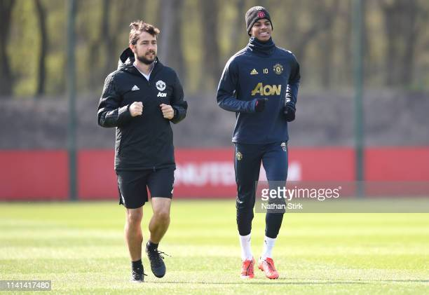 Marcus Rashford of Manchester United and Paolo Gaudino Manchester United fitness coach jog together during the Manchester United training session...