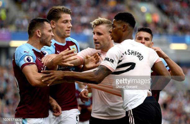 Marcus Rashford of Manchester United and Phil Bardsley of Burnley clash leading to a red card for Rashford during the Premier League match between...