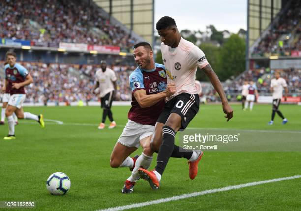 Marcus Rashford of Manchester United and Phil Bardsley of Burnley tussle for the ball during the Premier League match between Burnley FC and...
