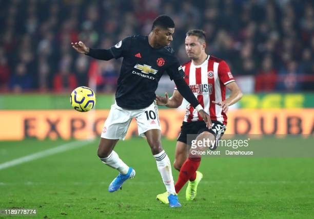 Marcus Rashford of Manchester United and Phil Jagielka of Sheffield United in action during the Premier League match between Sheffield United and...