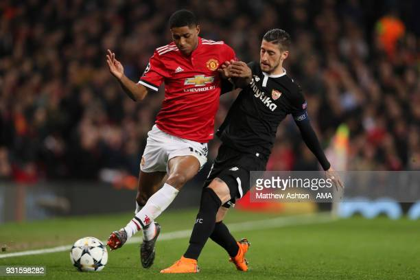Marcus Rashford of Manchester United and Sergio Escudero of Sevilla during the UEFA Champions League Round of 16 Second Leg match between Manchester...