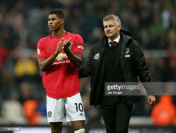 Marcus Rashford of Manchester United applauds fans after his sides defeat in the Premier League match between Newcastle United and Manchester United...